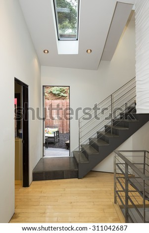 Modern staircase in private home leading to outdoors.  - stock photo