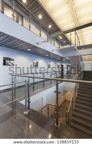 Modern staircase with glass banister in a office centre - stock photo