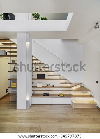 modern staircase with shelves under the stair itself - stock photo
