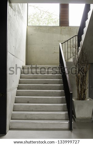 Modern  stairs with wooden handrail - stock photo