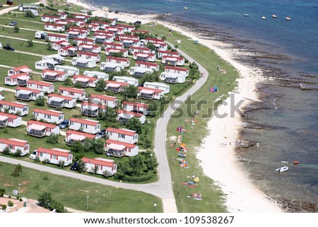 Modern static caravan on campsite during summer near the sea, holiday or vacation scene. Adriatic sea, Croatia - Aerial view - stock photo