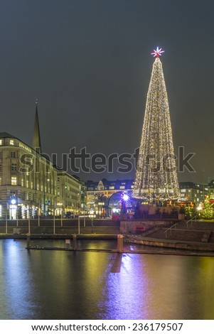 Modern steel christmas tree on the christmas market in downtown hamburg, germany - stock photo