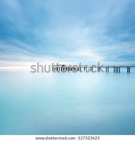 Modern steel pier in a cold atmosphere Long exposure photography in Lido Camaiore, Versilia, Tuscany, Italy, Europe - stock photo
