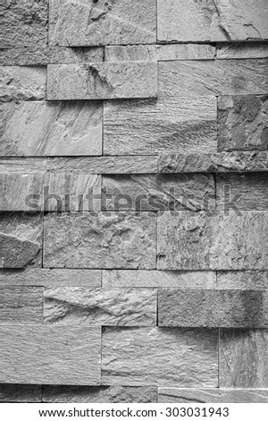 Modern stone wall background or texture (monochrome photo). - stock photo