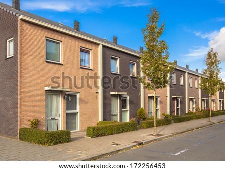 Modern Street with Terraced Houses in Suburban Neighborhood - stock photo