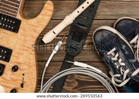 Modern 7 string electric guitar with natural finish - stock photo