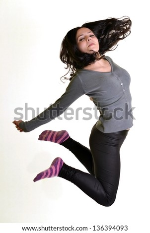 modern style dancer jumping against isolated white background - stock photo