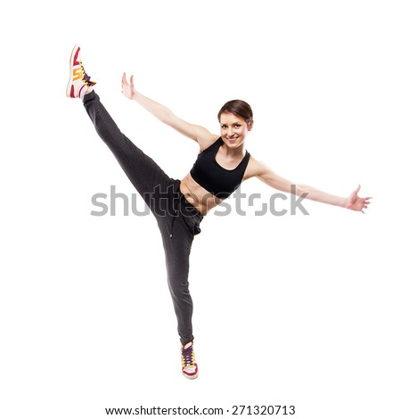 modern style dancer posing hodling leg on studio background - stock photo