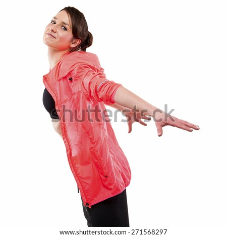modern style dancer posing with hands on back in studio background - stock photo