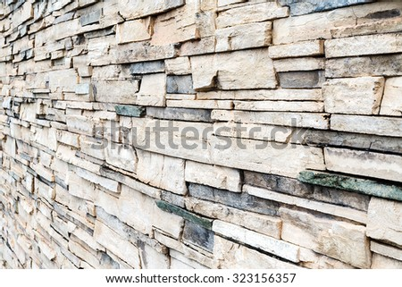 Modern style design decorative uneven cracked real stone wall surface with cement, old vintage (select focus) - stock photo