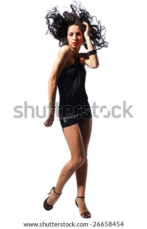 modern style girl jumping behind studio background - stock photo