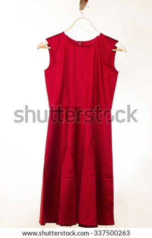 modern style red female indian dress on hanger isolated on white background - stock photo