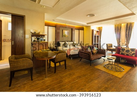 Modern styles of living room including bed at resort in Thailand - stock photo