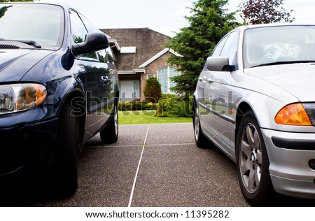 modern suburban family life - 2 cars & a house - stock photo
