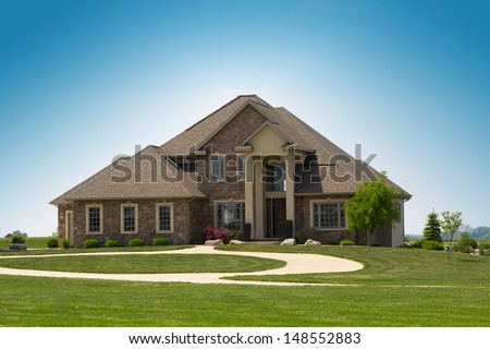 modern suburban stone detached house - stock photo