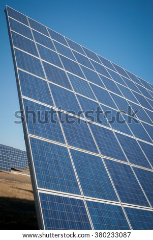 Modern sun energy farm solar panels, for eco and nature renewable prodution. - stock photo
