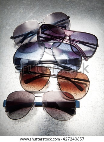 modern sunglasses on a composition with a beautiful light with shadows in pan - stock photo