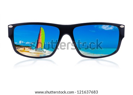 Modern sunglasses with a tropical beach reflection isolated on a white background - stock photo
