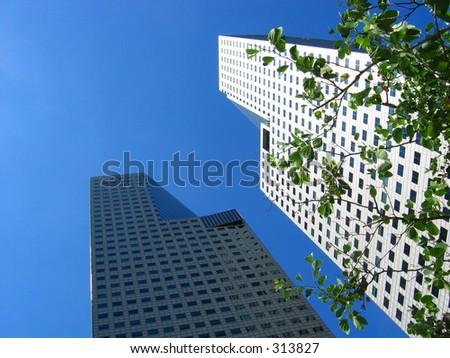 Modern Suntec City Towers on a clear blue sunny day - stock photo