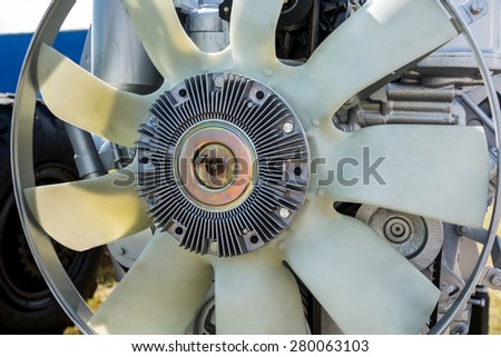 Modern system of cooling with a large fan blades from the car engine closeup - stock photo