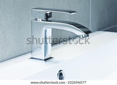 modern ta in bathroom closeup image - stock photo