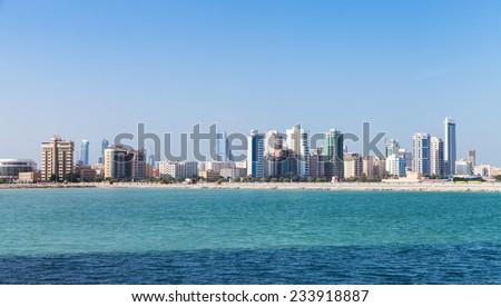 Modern tall buildings on the horizon. Skyline of Manama city, Bahrain - stock photo