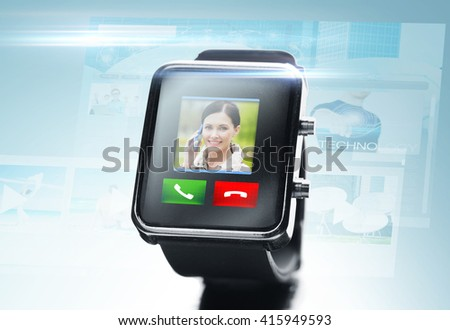 modern technology, communication, object and media concept - close up of black smart watch with video call contact icon and buttons over blue background - stock photo