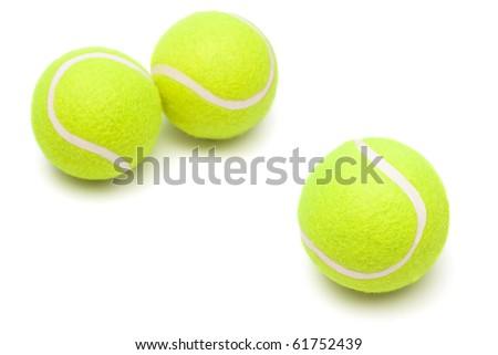 modern tennis balls on a white background - stock photo