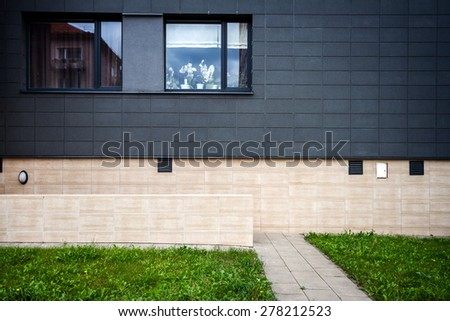 Modern tile wall with some windows - stock photo