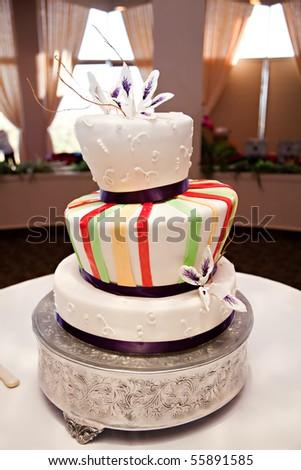 Modern tilted wedding cake - stock photo