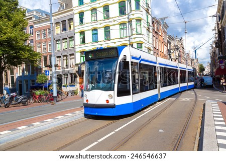 Modern tram in Amsterdam. Amsterdam is the capital and most populous city of the Netherlands - stock photo