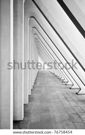 Modern tunnel in futuristic interior with concrete arches in perspective - stock photo