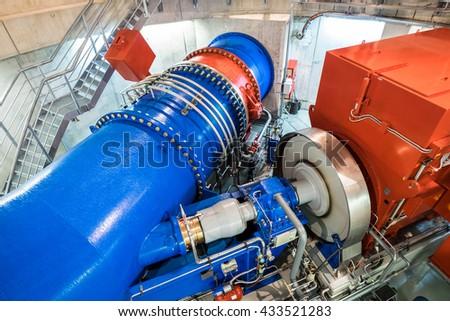 modern turbine at a power station - stock photo