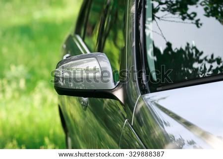 Modern turn signal on rear view mirror - stock photo