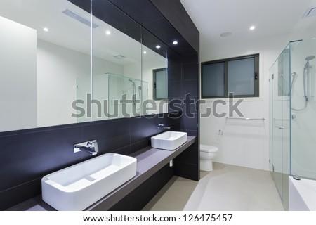 Modern twin bathroom in stylish Australian home - stock photo