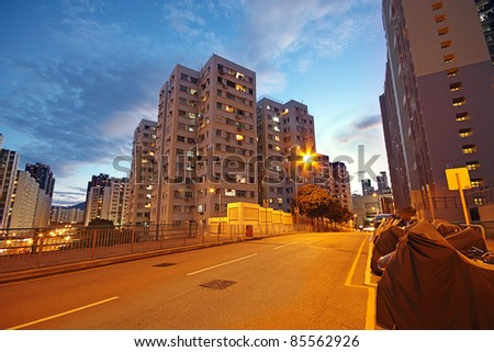 modern urban city at night with freeway traffic - stock photo