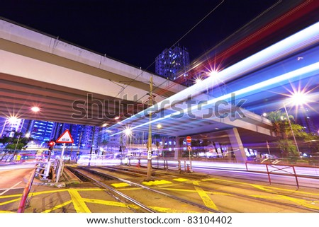modern urban city at night with traffic - stock photo