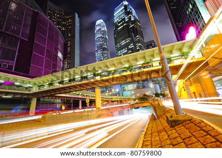 modern urban city traffic at night - stock photo
