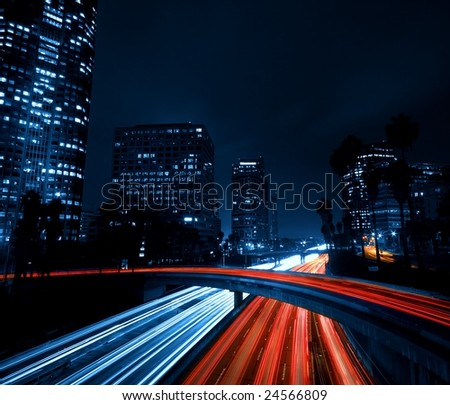 Modern Urban City with Freeway Traffic at Night, Dark City Skyline, Down Town Los Angeles - stock photo