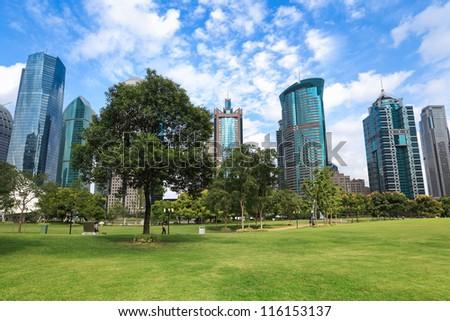 modern urban landscape, greenbelt park in shanghai - stock photo