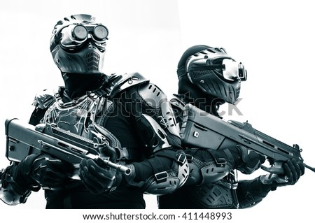 Modern urban soldiers of special elite commando units posing in special black tactical uniform with machine guns with white background - stock photo