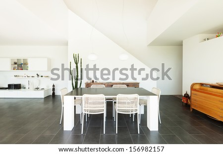 Modern villa, interior, dining table view - stock photo