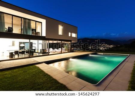 Modern villa, night scene,view from poolside - stock photo