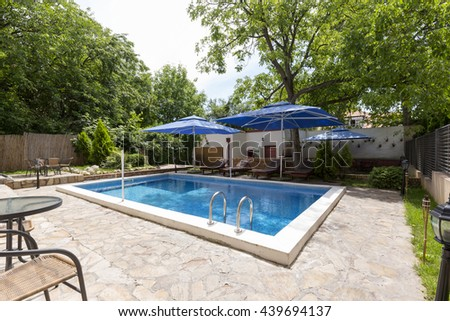 Modern villa with swimming pool  - stock photo