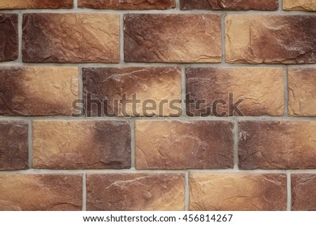 Modern Vintage Stone Tiled Wall From Rectangular Textured Tiles Background In Brown Yellow Color, Close Up, Copy Space, Construction Finishing Materials - stock photo
