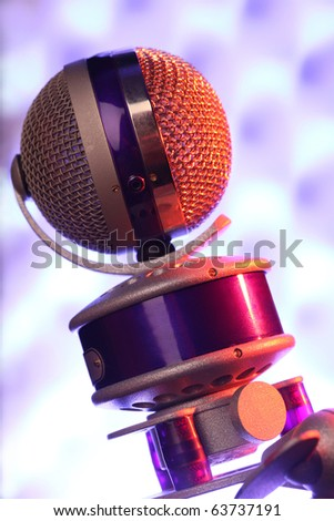 modern violet microphone against sonic foam - stock photo