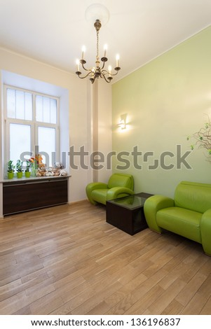 Modern waiting room with a wooden floor - stock photo