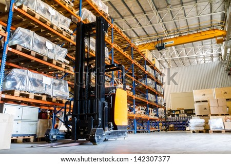 Modern warehouse with forklifts - stock photo