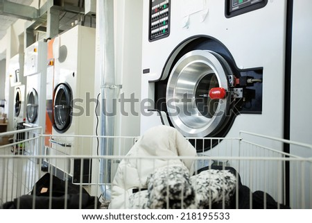 Modern washing machines in laundry room - stock photo