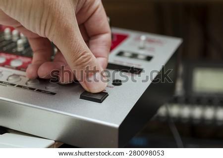 Modern way of creating music, DJ at work, close-up shot with selective focus - stock photo